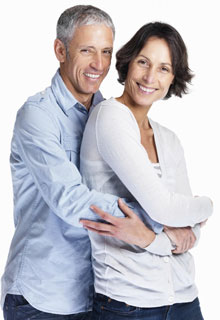 A smiling older couple illustrate the great reviews our Dentist in Seattle receives. Our patients are the best!