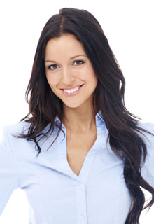 A smiling woman shows how dental Bonding from our Cosmetic Dentistry experts in Seattle can improve your smile.
