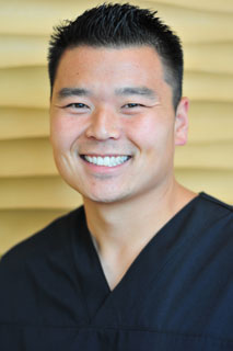 Dr. John Kim, a dentist in Seattle with years of experience
