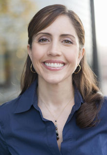 A businesswoman smiles to show how Cosmetic Dentistry from our Seattle, WA dentist can transform your smile